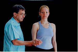 Therapist performing a resisted lateral rotation test on client